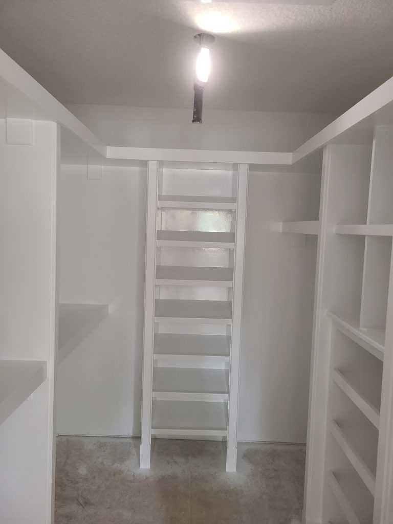 Painting shelf in basement after